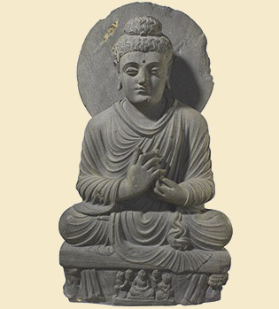 Seated Buddha from Gandhara , one of the earliest images of Buddha, created between 100-300 C.E. (© British Museum)
